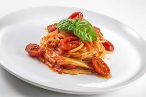 Plate of spaghetti with tomato and basil photo