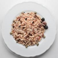 Risotto anchovies capers tomato olives photo