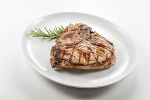Grilled t-bone chop of pork photo