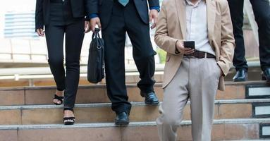 Businessman's legs walking the stairs in modern city