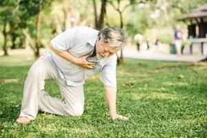 Senior man feeling pain suffering from heart attack outdoor