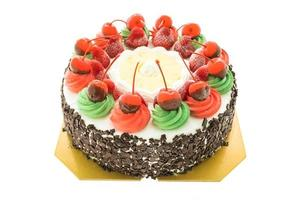 Ice cream cake with Christmas theme and cherry on top photo