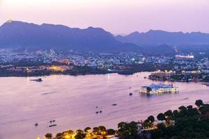 Udaipur city at lake Pichola in the evening, Rajasthan, India photo