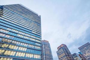 Windows of skyscraper buildings in Tokyo City, Japan photo