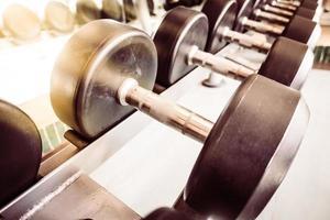 Dumbbell equipment in fitness gym photo