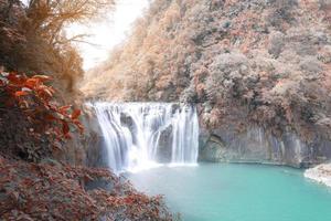 Waterfall in autumn photo