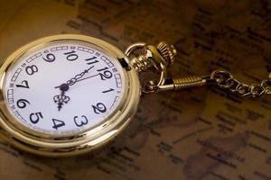 Gold pocket watch on ra map photo