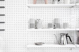 Modern kitchenware and utensils on shelves photo