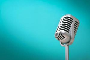 Retro style microphone on green background photo