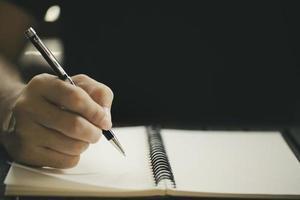 Hand posed to write photo