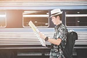 Male traveler at a train station photo