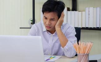 Young businessman stressed at work photo