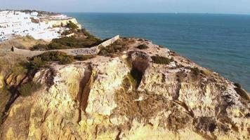 Panoramic view of Paradise Beach, cliffs and downhill path in Carvoeiro - Aerial Panoramic reveal shot video