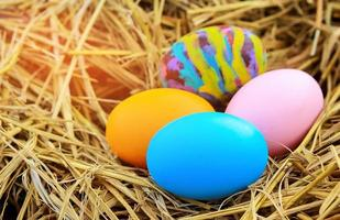 Easter eggs in straw photo