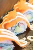 Salmon sushi roll, traditional Japanese food photo