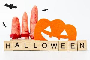 Halloween party props with wooden blocks with the text Halloween on a white background photo