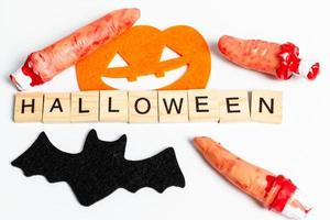 Halloween party props with wooden blocks with the text Halloween on a white background