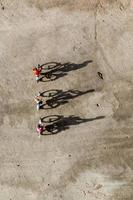Miniature travelers riding bicycles, healthy lifestyle concept