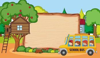 Empty wooden board in park scene with many kids on school bus vector
