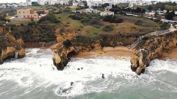 Waves crashing on rocks and cliffs along Lagos coastline, Algarve, Portugal video