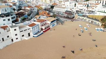 Picturesque Carvoeiro beach and resort town, Algarve. Aerial panoramic view video