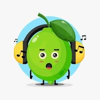 Cute lime mascot listening to music vector