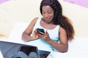 Young woman looking her mobile phone