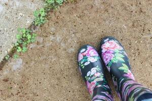 Pair of black and multicolored floral boots