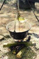 Cooking outdoor on a fire in a pot