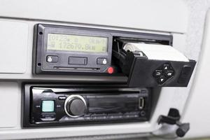 Digital tachograph with open printer and visible roll of paper photo
