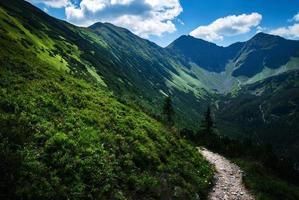 Valley below the mountain ridge photo