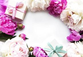 Peonies and gift boxes photo