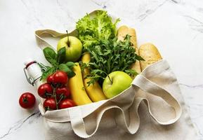 Eco natural bag with fruits and vegetables, eco friendly, flat lay photo
