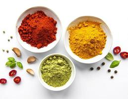 Various spices isolated on white background, top view photo