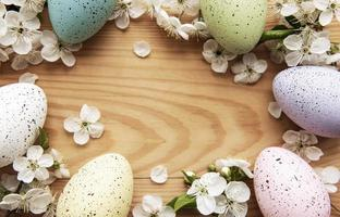 Colorful Easter eggs with spring blossom flowers