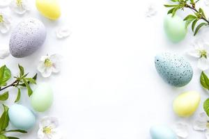 Colorful Easter eggs with spring blossom flowers photo