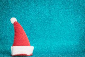 Santa Claus red hat on a sparkling background, Christmas season celebration concept