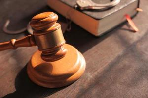 Gavel and book on table close up photo