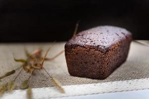 Black whole grain bread sliced on the table photo