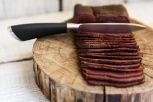 Pastrami on the wood table photo