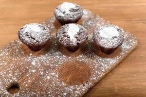 Chocolate muffins on the wood board