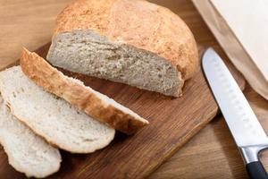 Grain bread on the wood board photo