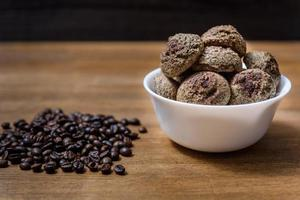 Coffee cookies in a plate with sprinkled coffee beans photo