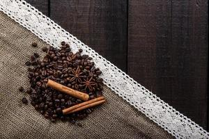 Black coffee with grains and cinnamon photo