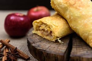Apple strudel on wooden end of a tree photo
