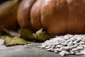 Pumpkins lying on a wooden table photo