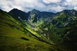 Green rocky mountain valley photo