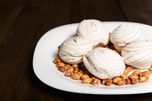 Marshmallows and peanuts photo