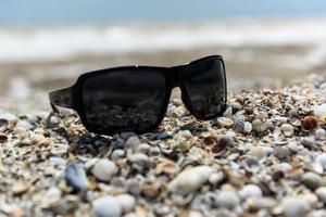 Sunglasses on the seashore