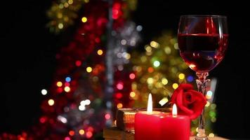 Red Rose and Wine and Candle with Colorful Bokeh in the Background